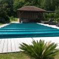 Bâche pour piscine avec barres