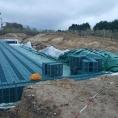 AVANT : Bâche de couverture pour un bassin solide de rétention d'eau de pluie