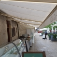 Store de terrasse en toile - vu de dessous